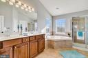 Master bath with a large soaking tub. - 25955 MCCOY CT, CHANTILLY