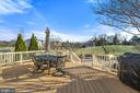 Large deck perfect for entertaining and grilling. - 25955 MCCOY CT, CHANTILLY