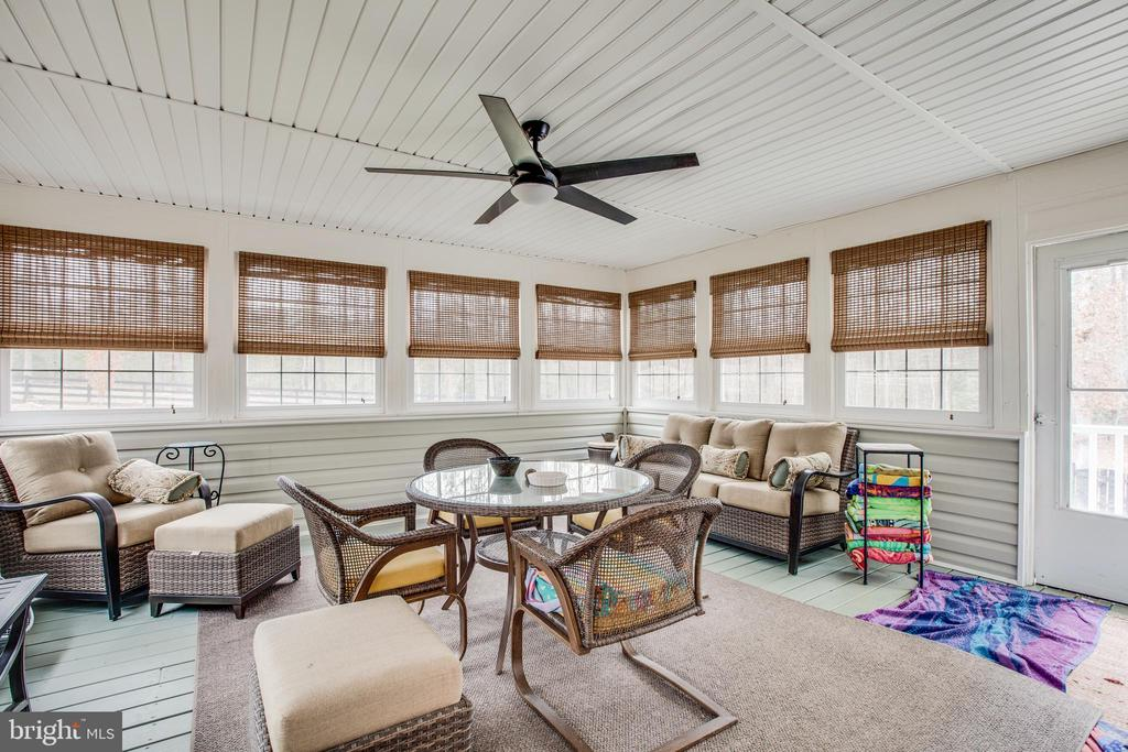 Huge sun room/porch overlooking the back yard - 8430 SWAN WOODS RD, RHOADESVILLE