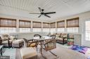 Huge sun room/porch overlooking the back yard - 8430 SWAN WOODS RD, RHOADESVILLE