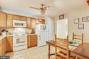 Big kitchen with lots of space for casual dining - 8430 SWAN WOODS RD, RHOADESVILLE