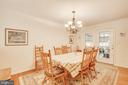 Formal dining room with entrance to the sun porch - 8430 SWAN WOODS RD, RHOADESVILLE