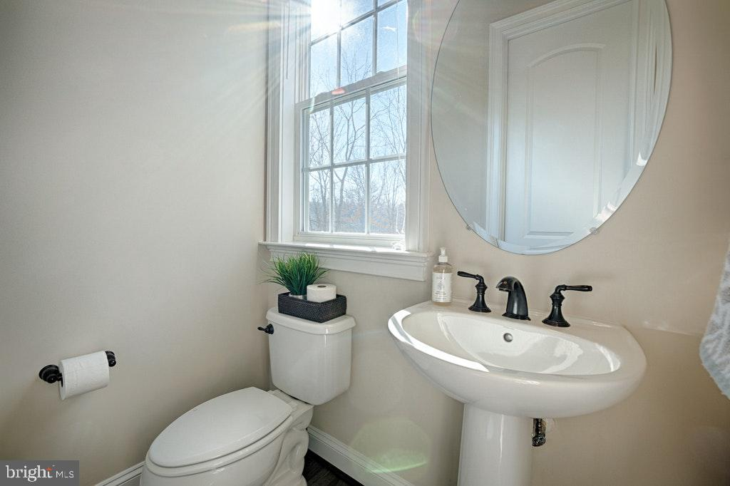 Main Floor half bath. - 39859 CHARLES HENRY PL, WATERFORD