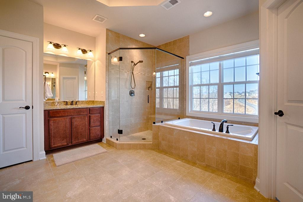 MasterBath has upgraded tile and frameless shower. - 39859 CHARLES HENRY PL, WATERFORD