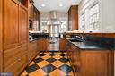 Custom cherry cabinets meet the ceiling - 1714 N CALVERT ST, ARLINGTON