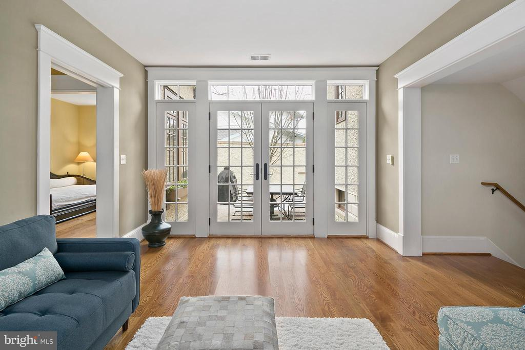 French doors open to brick patio - 1714 N CALVERT ST, ARLINGTON