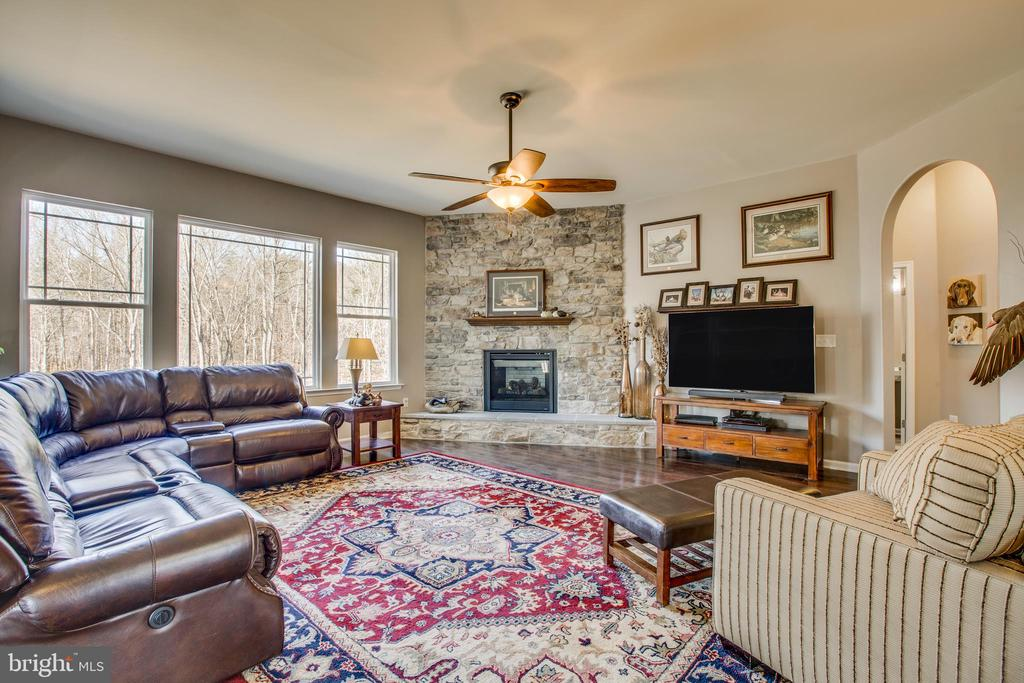 Beautiful stacked stone fireplace in Family room. - 215 ROCK RAYMOND DR, STAFFORD