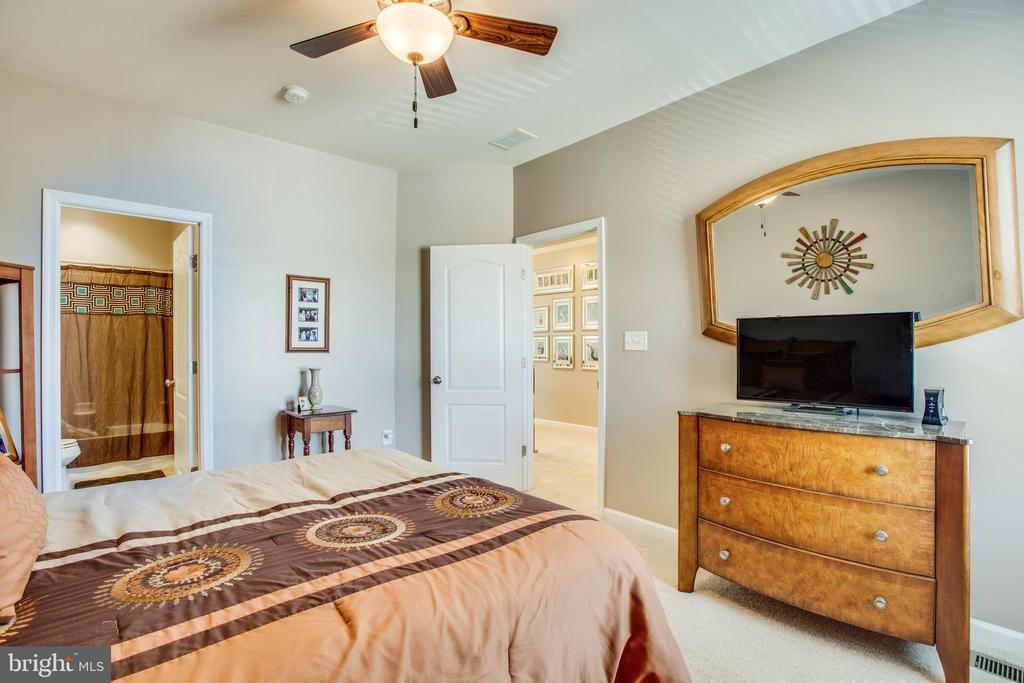 Large secondary bedrooms all have ceiling fans. - 215 ROCK RAYMOND DR, STAFFORD