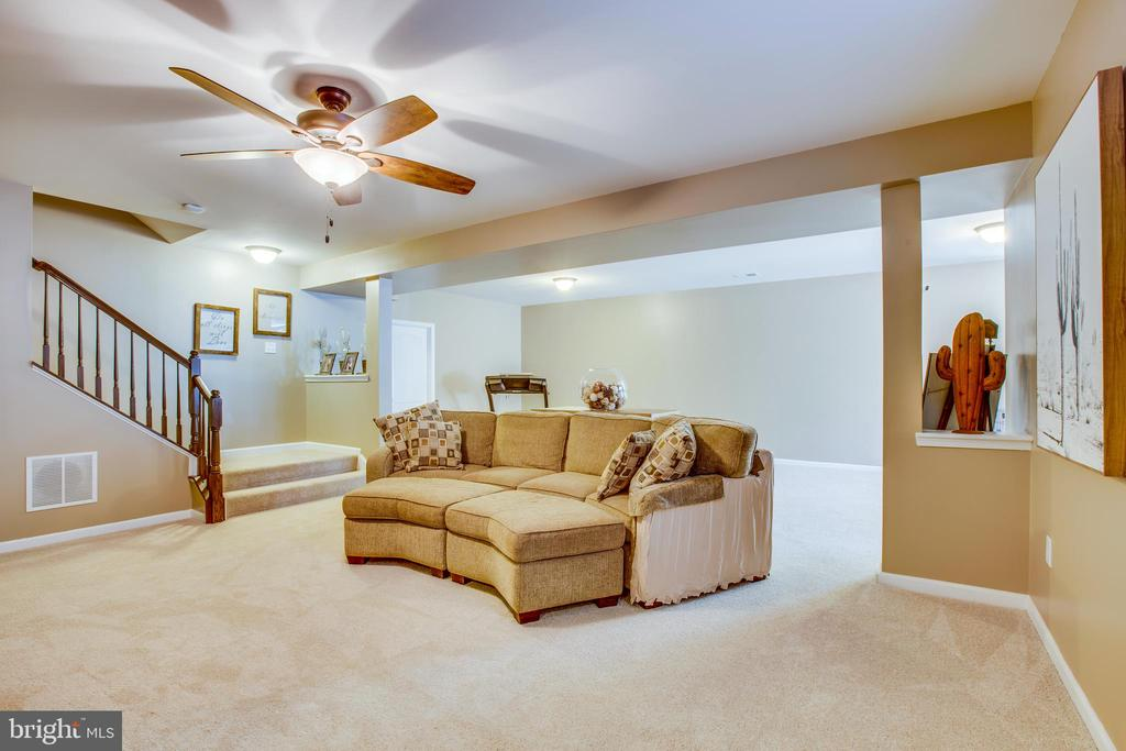 Walk out of lower level to fenced yard and patio. - 215 ROCK RAYMOND DR, STAFFORD