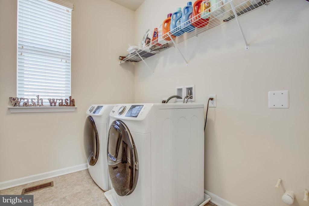 No need to haul laundry.  Upper level laundry room - 215 ROCK RAYMOND DR, STAFFORD