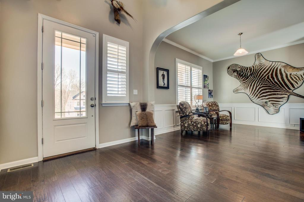 Formal dining room with lots of natural light. - 215 ROCK RAYMOND DR, STAFFORD