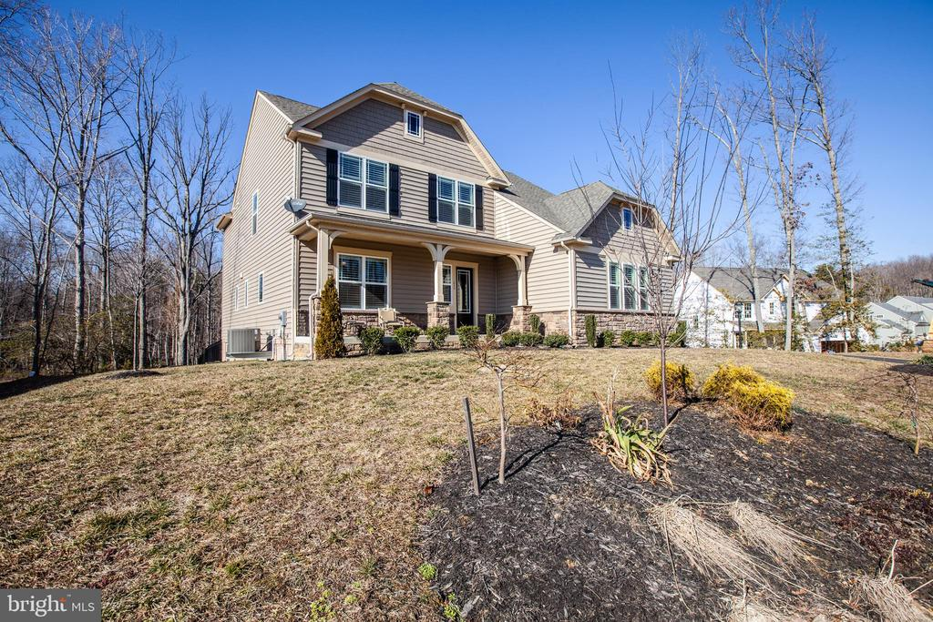 Surrounded by trees and landscaping. - 215 ROCK RAYMOND DR, STAFFORD