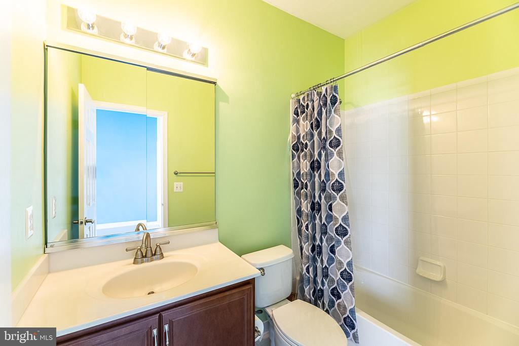 Second bedroom also has it's own attached bath! - 20404 TRAILS END TER, ASHBURN