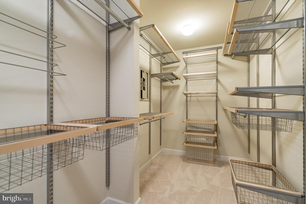 Large walk-in closet with elfa shelving & safe - 25975 MCCOY CT, CHANTILLY