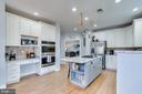 .White cabinets, new granite and HW floors - 122 LAWSON RD SE, LEESBURG
