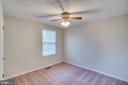 Bedroom with ceiling fan - 8189 SHIPS CURVE LN, SPRINGFIELD