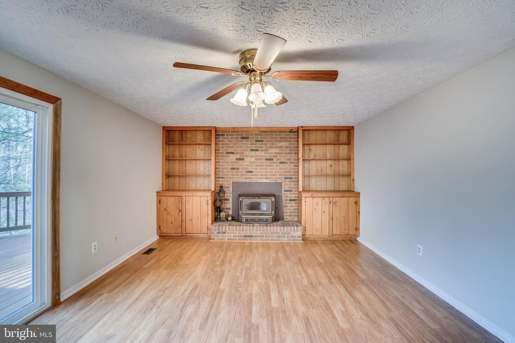 Family room has built ins and wood stove - 8189 SHIPS CURVE LN, SPRINGFIELD
