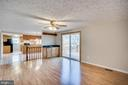 Family room has patio doors that lead to deck - 8189 SHIPS CURVE LN, SPRINGFIELD
