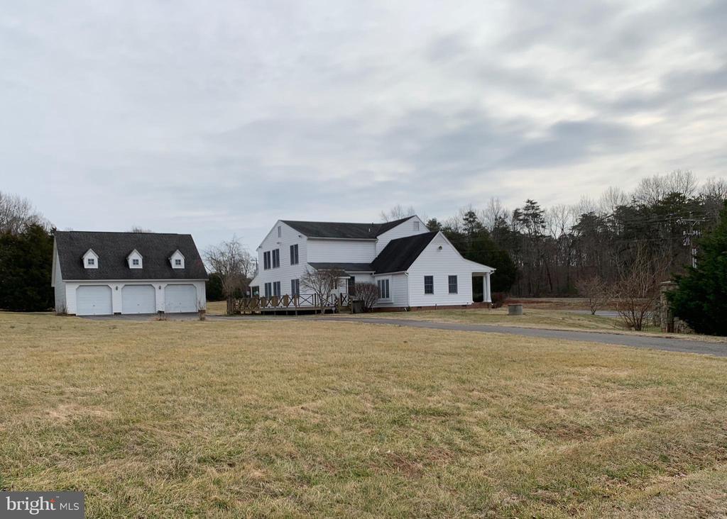 Exterior house view showing deck, 3 Car Garage - 13201 FOX GATE DR, SPOTSYLVANIA