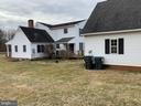 Exterior back view of home and 3 car garage - 13201 FOX GATE DR, SPOTSYLVANIA