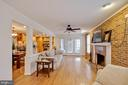 Wood burning fireplace. French doors to porch. - 7506 BOX ELDER CT, MCLEAN