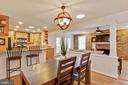 Open concept kitchen, dining room and family room. - 7506 BOX ELDER CT, MCLEAN