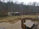 Stamped concrete patio and fenced yard. - 215 ROCK RAYMOND DR, STAFFORD