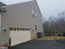 Large side load garage with lots of storage space. - 215 ROCK RAYMOND DR, STAFFORD
