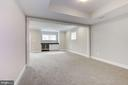 Low level living room with wine fridge - 4522 CHELTENHAM DR, BETHESDA