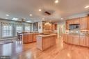 Kitchen Island with Gas Cooktop and Pendant Lights - 70 ALDERWOOD DR, STAFFORD