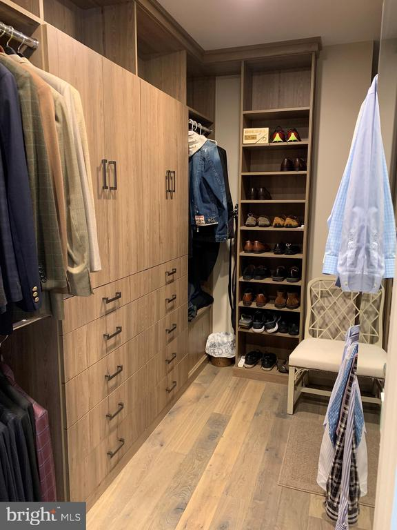 His closet is understated & efficient - 7301 DULANY DR, MCLEAN