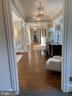 Elegant hallway from which 1st floor rooms flow - 7301 DULANY DR, MCLEAN