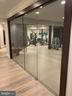 Commercial glass doors into HUGE workout room - 7301 DULANY DR, MCLEAN