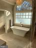 1st elegant mstr bath w/Haisa marble flooring - 7301 DULANY DR, MCLEAN