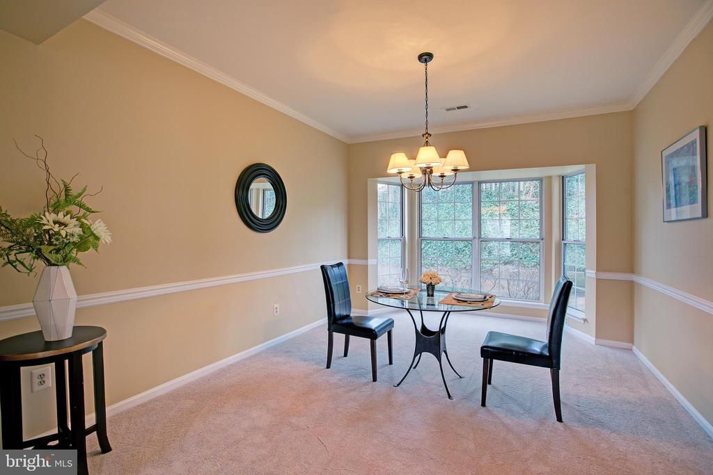 Dining room with walk in bay window - 12311 CLIVEDEN ST, HERNDON