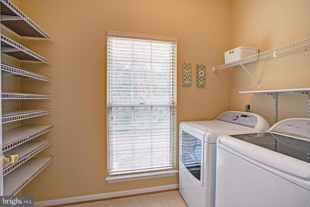 Large laundry room with storage - 12311 CLIVEDEN ST, HERNDON