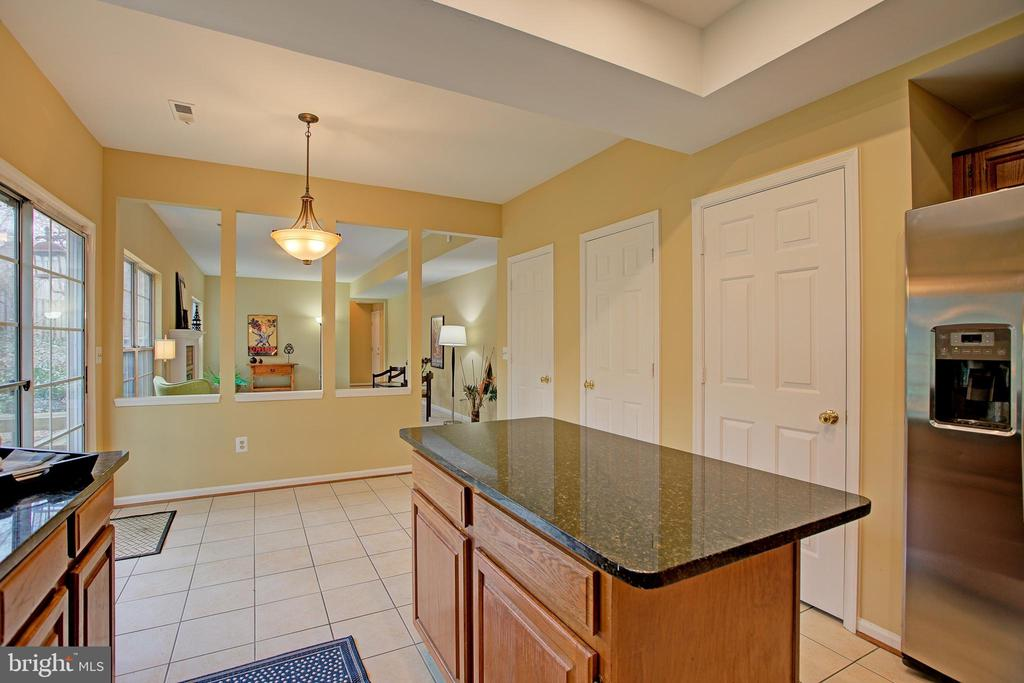 Kitchen Island, ceramic tile floors - 12311 CLIVEDEN ST, HERNDON