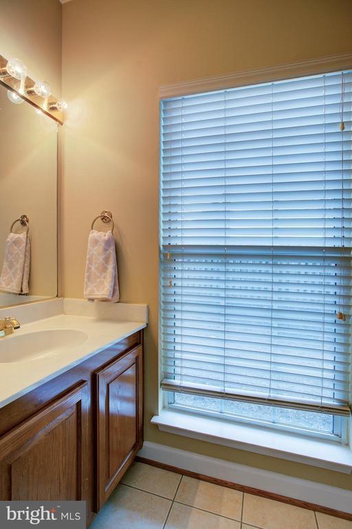 Main level half bath - 12311 CLIVEDEN ST, HERNDON
