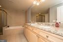 Spa bath with a Jacuzzi tub. - 11990 MARKET ST #1117, RESTON