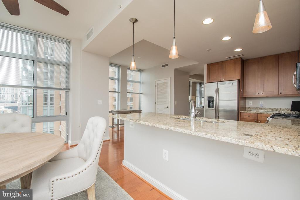 Open kitchen over looking the sun room. - 11990 MARKET ST #1117, RESTON