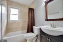 Renovated bathroom with ceramic tile - 15223 CRESCENT ST, WOODBRIDGE