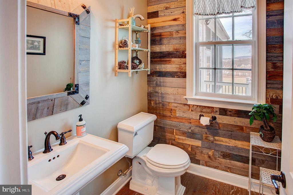 Barn wood accent wall in powder room - 18607 MONTAGUE PL, PURCELLVILLE