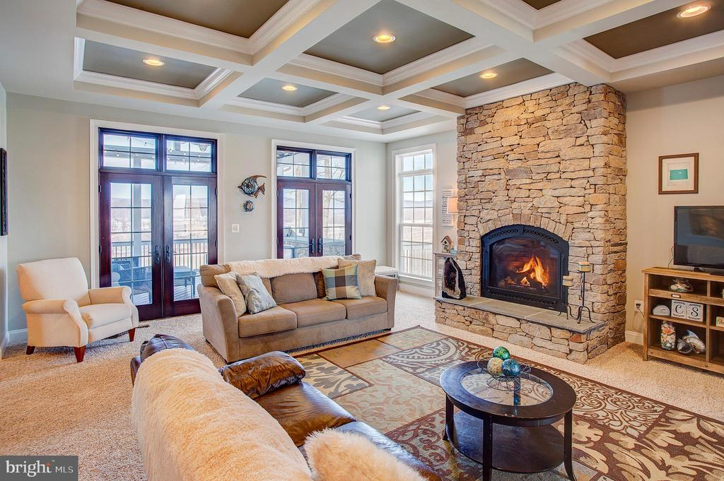 Family room has coffered ceilings and fireplace - 18607 MONTAGUE PL, PURCELLVILLE