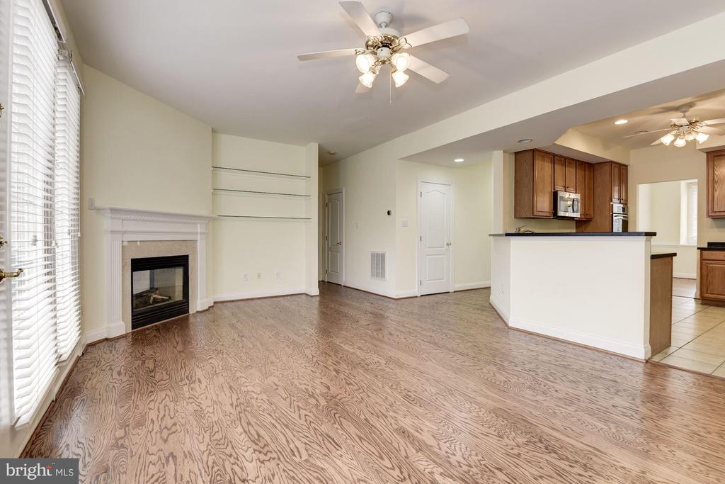 Family Room opening to Kitchen. - 18421 GREEN ISLAND TER, LEESBURG
