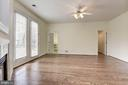Main level Master Suite w/ gas fp, ceiling fan. - 18421 GREEN ISLAND TER, LEESBURG