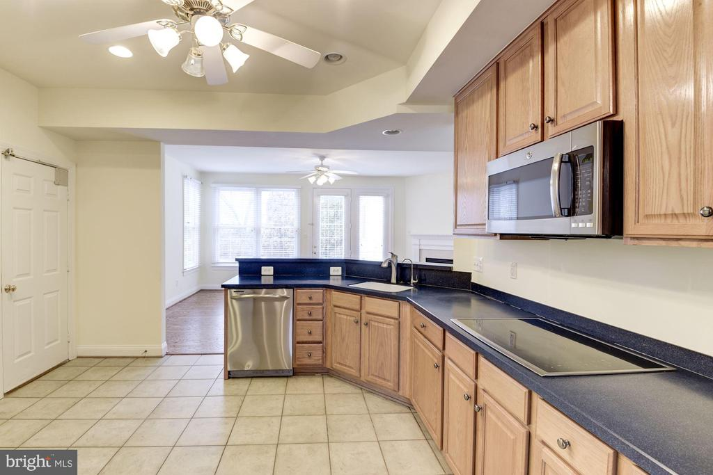 View of Kitchen opening to Family Room. - 18421 GREEN ISLAND TER, LEESBURG
