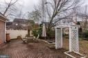 View of lovely brick patio, trellis and planters. - 18421 GREEN ISLAND TER, LEESBURG