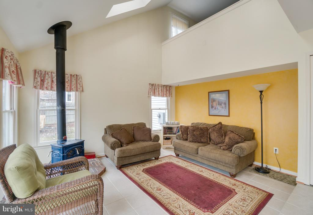 Family room with wood burning stove. - 3 BRYANT BLVD, STAFFORD