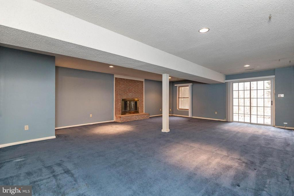 Spacious Rec Room in the basement leads to Patio - 13459 FOWKE LN, WOODBRIDGE