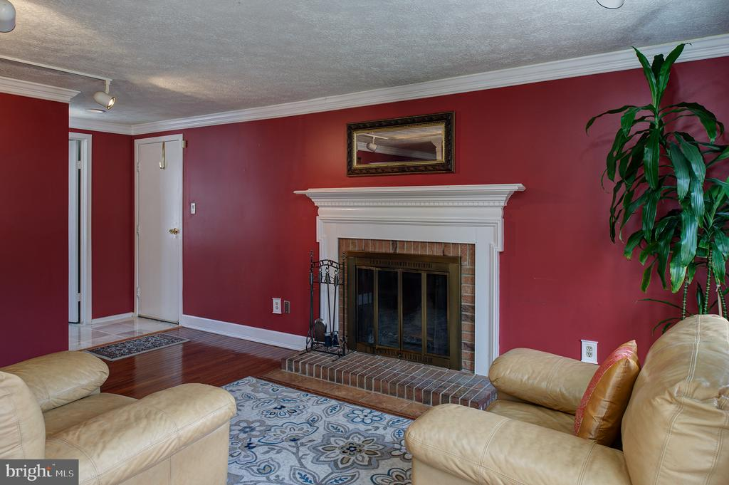 The fireplace in the study - 3295 BLUE HERON DR, FALLS CHURCH